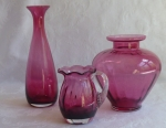 Pilgrim & other cranberry glass pitcher & vases